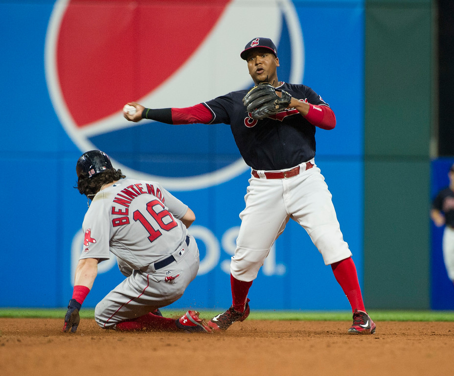 . Cleveland Indians\' Jose Ramirez forces Boston Red Sox\' Andrew Benintendi out at second and throws to first to complete a double play in the seventh inning of a baseball game in Cleveland, Monday Aug. 21, 2017. (AP Photo/Phil Long)