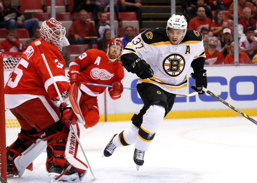 . Boston Bruins center Patrice Bergeron (37) skates against the Detroit Red Wings in the first period of a NHL hockey game in Detroit Wednesday, Oct. 15, 2014. (AP Photo/Paul Sancya)
