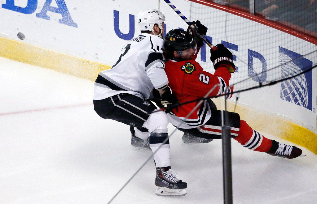 . Los Angeles Kings left wing Kyle Clifford (13) and Chicago Blackhawks defenseman Duncan Keith (2) collide during the first period in Game 7 of the Western Conference finals in the NHL hockey Stanley Cup playoffs Sunday, June 1, 2014, in Chicago. (AP Photo/Charles Rex Arbogast)