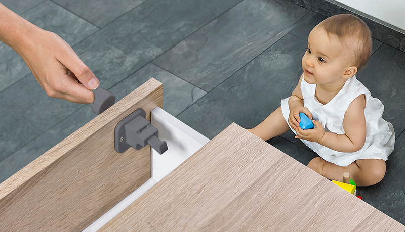 Fred_Home_Safety_Invisible_Magnet_Lock_Lifestyle_grey_baby.jpg