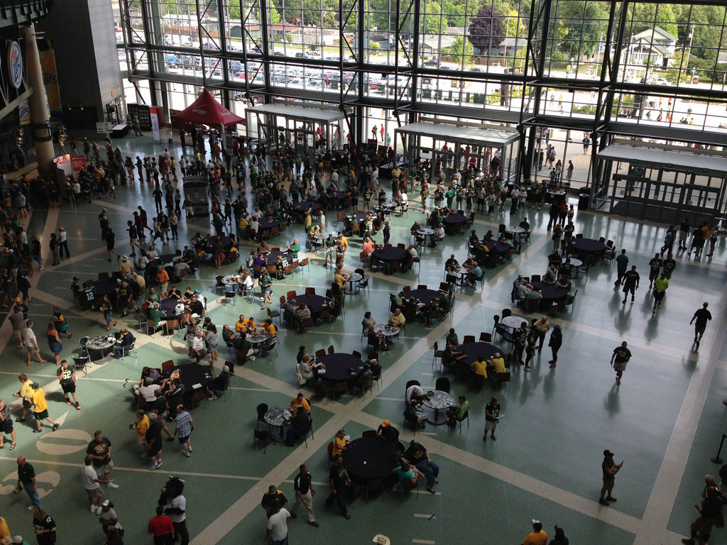 . The floor of the Lambeau Field Atrium in Green Bay crawls with NFL owners at the Packers\' annual meeting of shareholders.  (Pioneer Press: Alex Smith)