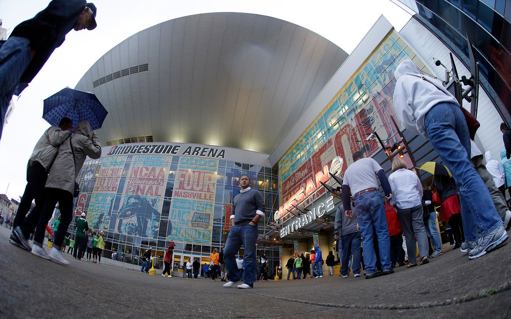 . Fans walk into Bridgestone Arena before the first half of the championship game between Notre Dame and Connecticut in the Final Four of the NCAA women\'s college basketball tournament, Tuesday, April 8, 2014, in Nashville, Tenn. (AP Photo/Mark Humphrey)