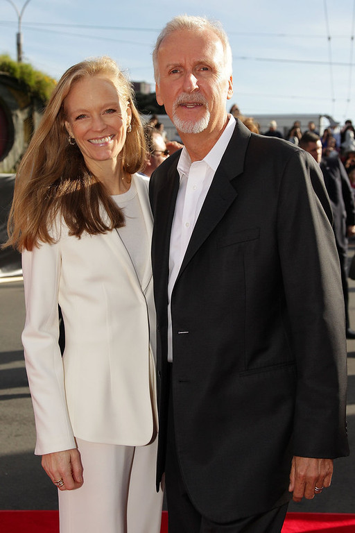 ". Film director James Cameron and wife Suzy Amis arrive at the ""The Hobbit: An Unexpected Journey\"" World Premiere at Embassy Theatre on November 28, 2012 in Wellington, New Zealand.  (Photo by Hagen Hopkins/Getty Images)"