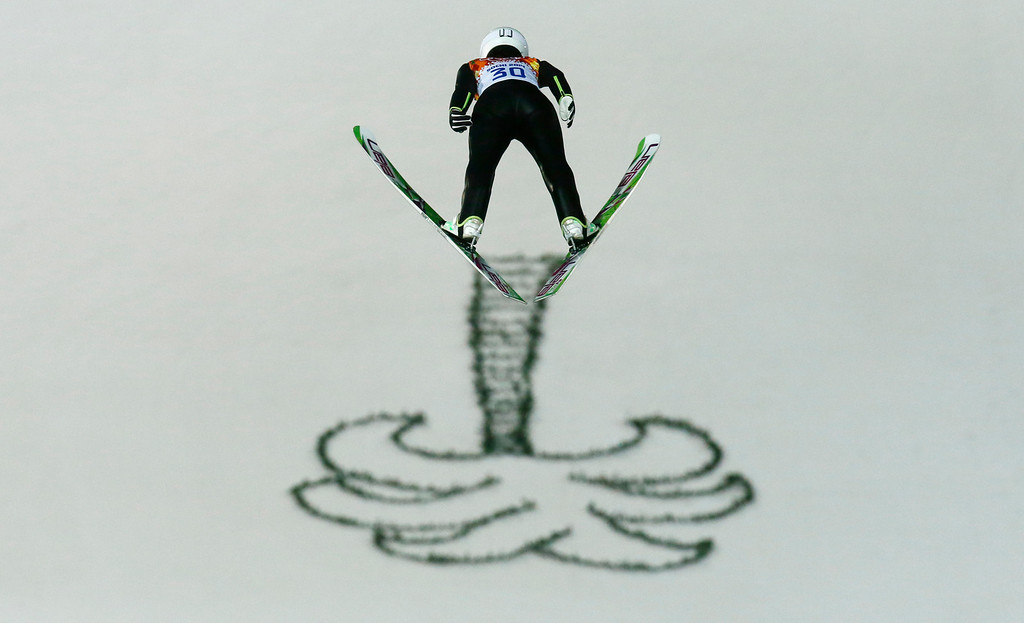 . Japan\'s Sara Takanashi makes her first attempt during the women\'s normal hill ski jumping final at the 2014 Winter Olympics, Tuesday, Feb. 11, 2014, in Krasnaya Polyana, Russia. (AP Photo/Gregorio Borgia)