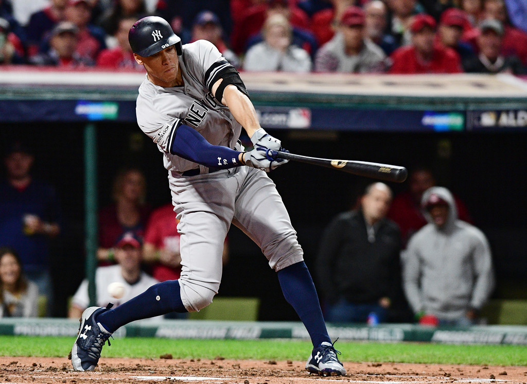 . New York Yankees\' Aaron Judge strikes out swinging against Cleveland Indians starting pitcher Corey Kluber during the third inning of Game 5 of a baseball American League Division Series, Wednesday, Oct. 11, 2017, in Cleveland. (AP Photo/David Dermer)