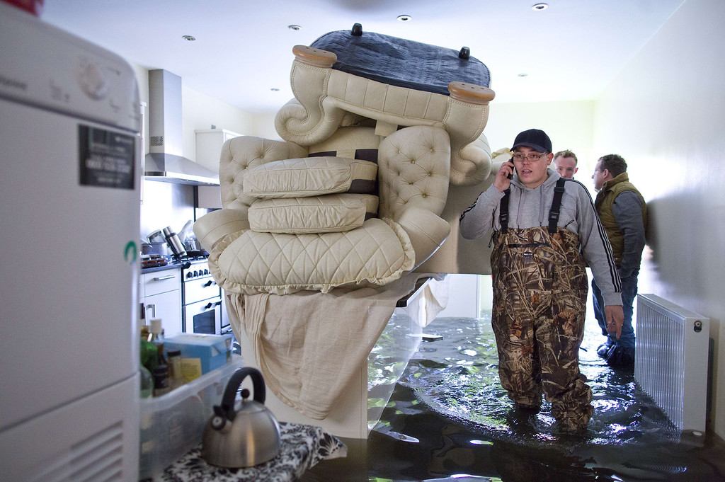 . A local resident wades through his flooded kitchen as he returns to his home in Egham on February 11, 2014.   Driven by the wettest winter in England since 1766, the floods first hit southwest England about seven weeks ago. But they are now creeping eastwards towards London, into the wealthy suburbs lining the River Thames which are the heartland of Cameron\'s centre-right Conservative party. AFP PHOTO / JUSTIN TALLIS/AFP/Getty Images