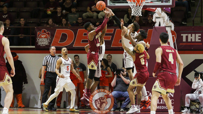 Wabissa Bede blocks a shot by Boston College's Jared Hamilton late in the second half. (Mark Umansky/TheKeyPlay.com)