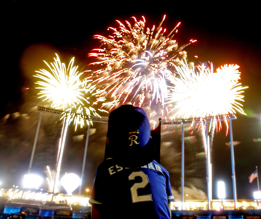 . Massi Escobar, 4, the son of Kansas City Royals shortstop Alcides Escobar, watches fireworks after a baseball game between the Royals and the Cleveland Indians on Friday, Aug. 24, 2018, in Kansas City, Mo. The Royals won 5-4. (AP Photo/Charlie Riedel)