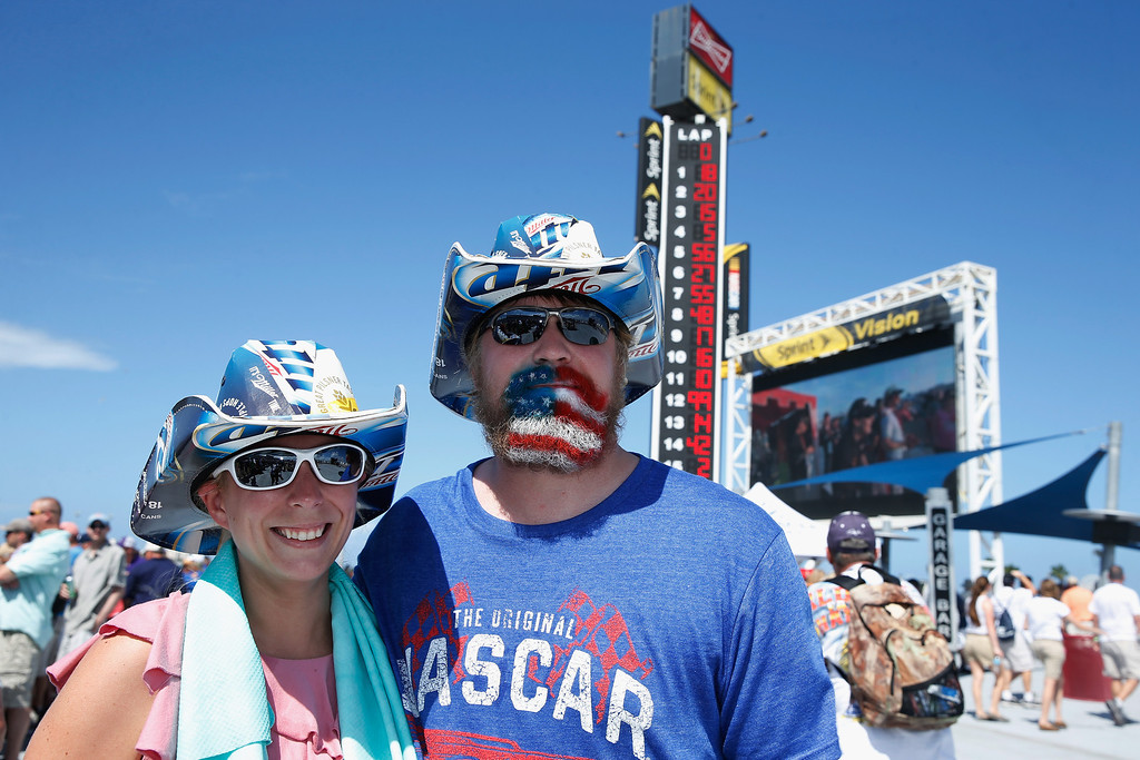 . DAYTONA BEACH, FL - JULY 06:  Fans pose for a photo in the infield during the NASCAR Sprint Cup Series Coke Zero 400 at Daytona International Speedway on July 6, 2013 in Daytona Beach, Florida.  (Photo by Scott Halleran/Getty Images)