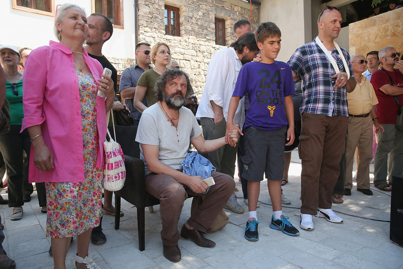 . Serbian filmmaker Emir Kusturica (seated) listens to a band play in the mock-village of Andricgrad on St. Vitus Day in Srpska Republika on June 28, 2014 in Visegrad, Bosnia and Herzegovina. Serbian leaders are scheduled to hold ceremonies at Andricgrad later in the day to mark the centenary of the assassination of Austrian Archduke Franz Ferdinand on June 28, 1914, by Serbian secessionist Gavrilo Princip, an event that propelled Europe into World War I. The city of Sarajevo is holding its own commemoration, though Serbian leaders are boycotting the Sarajevo events, claiming the Bosniaks have turned the commemoration too partisan. Andricgrad was built by Kusturica and will become the set for a film about Yugoslav poet Ivo Andric.  (Photo by Sean Gallup/Getty Images)