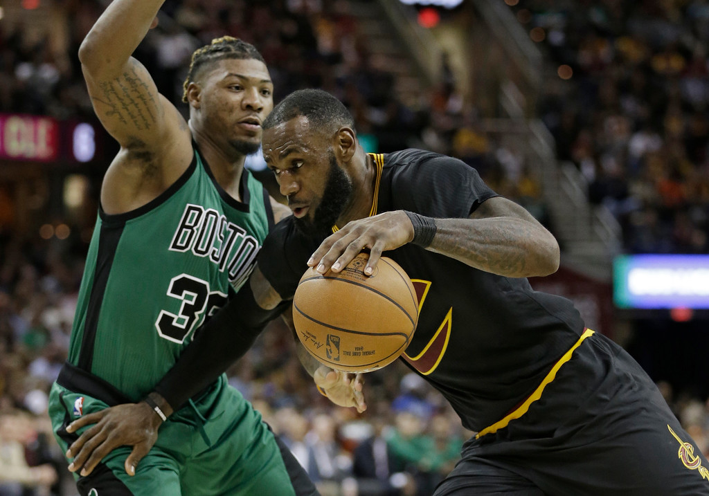 . Cleveland Cavaliers\' LeBron James, right, drives against Boston Celtics\' Marcus Smart (36) in the second half of an NBA basketball game, Thursday, Dec. 29, 2016, in Cleveland. (AP Photo/Tony Dejak)