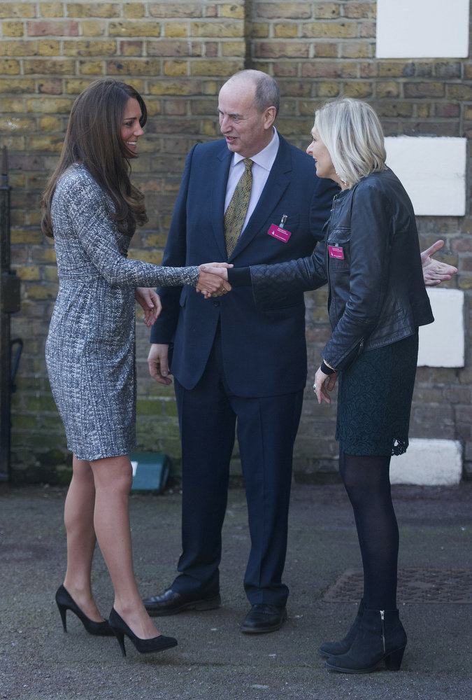 Description of . Britain's Catherine, Duchess of Cambridge (L) speaks with members of staff as shge arrives at the Hope House charity in south London on February 19, 2013.  The Duchess visited Hope House, an all-female rehabilitation centre which is is one of the projects run by her patronage, Action on Addiction.   CARL COURT/AFP/Getty Images
