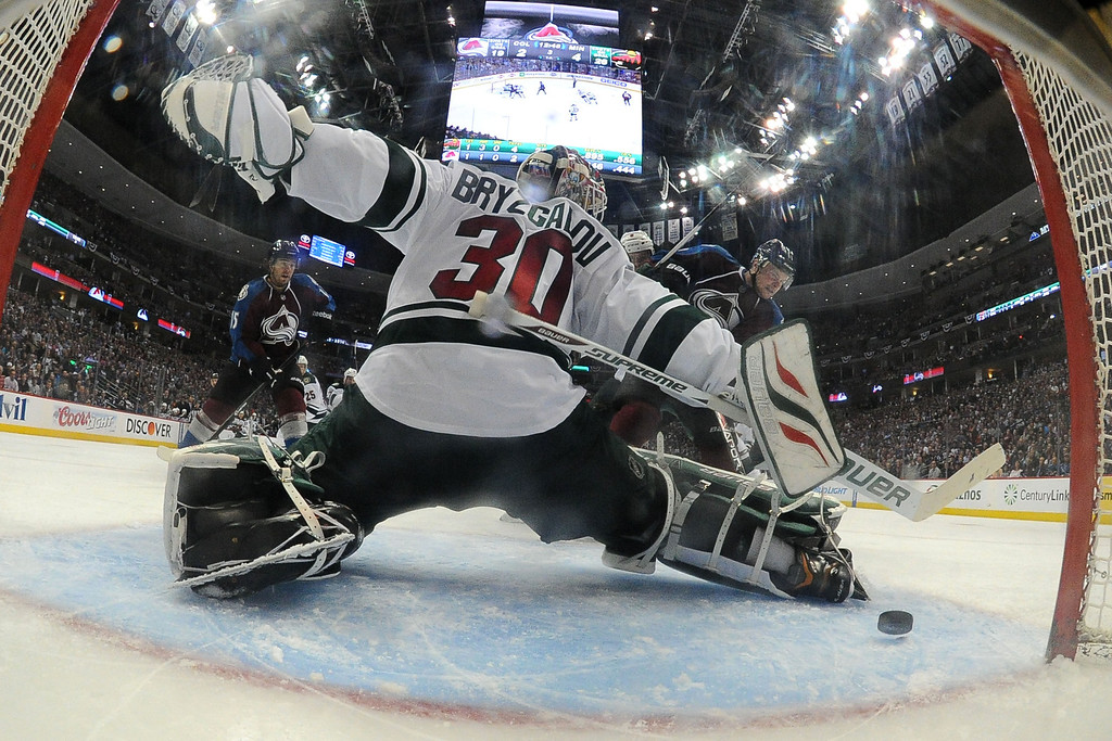. Jamie McGinn (11) of the Colorado Avalanche scores a 4-3 goal to bring the Avs within one as Ilya Bryzgalov (30) of the Minnesota Wild tends the net during the third period. The Colorado Avalanche hosted the Minnesota Wild in the first round of the NHL playoffs at the Pepsi Center on Thursday, April 17, 2014. (Photo by John Leyba/The Denver Post)