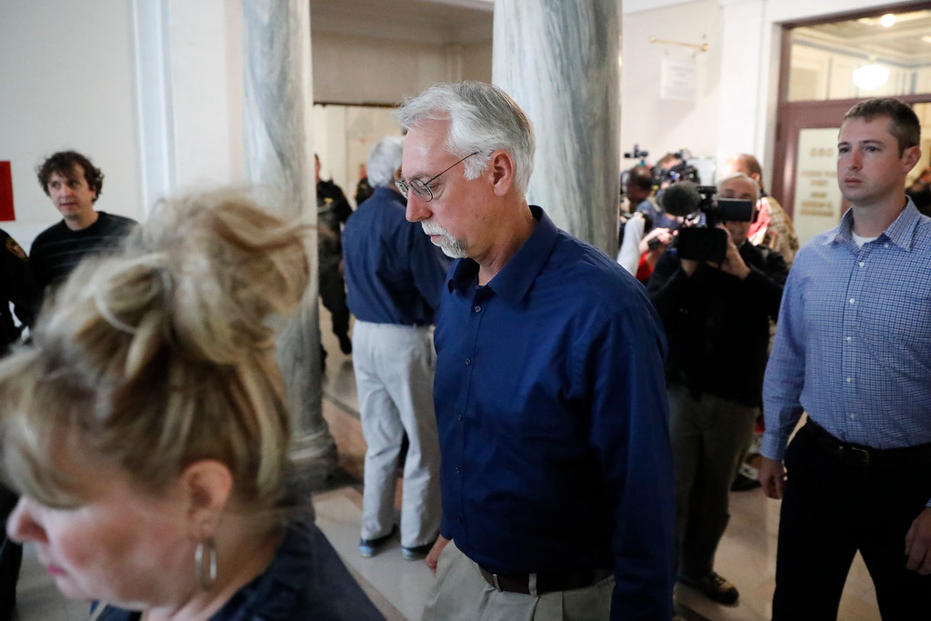 . Paul Tensing, father of Ray Tensing, leaves court after a mistrial is called in the murder trial against his son, Saturday, Nov. 12, 2016, in Cincinnati. The former University of Cincinnati police officer is charged with murdering Sam DuBose while on duty during a routine traffic stop on July 19, 2015. (AP Photo/John Minchillo)
