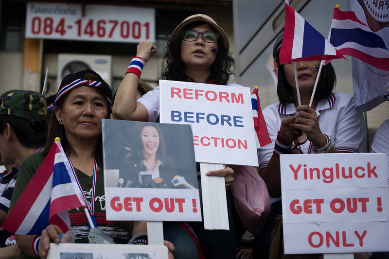 """. Thai anti-government protesters shout slogans at Asoke intersection during a rally in Bangkok on January 13, 2014. Thai opposition protesters launched their attempted \""""shutdown\"""" of Bangkok on January 13, occupying key intersections in the capital in an escalation of their campaign to unseat Prime Minister Yingluck Shinawatra. (NICOLAS ASFOURI/AFP/Getty Images)"""