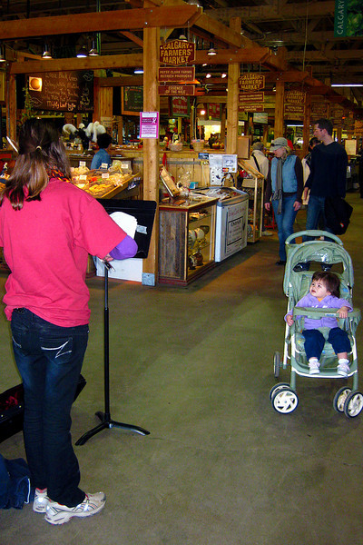 Julia enjoying the music at the farmers' market.