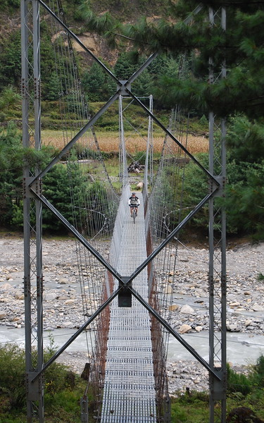 Scott coming across a suspension bridge.