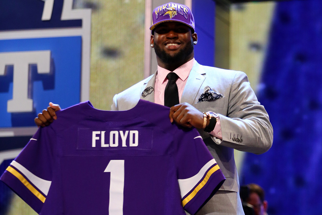 . Sharrif Floyd of the Florida Gators holds up a jersey on stage after he was picked #23 overall by the Minnesota Vikings in the first round of the 2013 NFL Draft at Radio City Music Hall on April 25, 2013 in New York City.  (Photo by Al Bello/Getty Images)