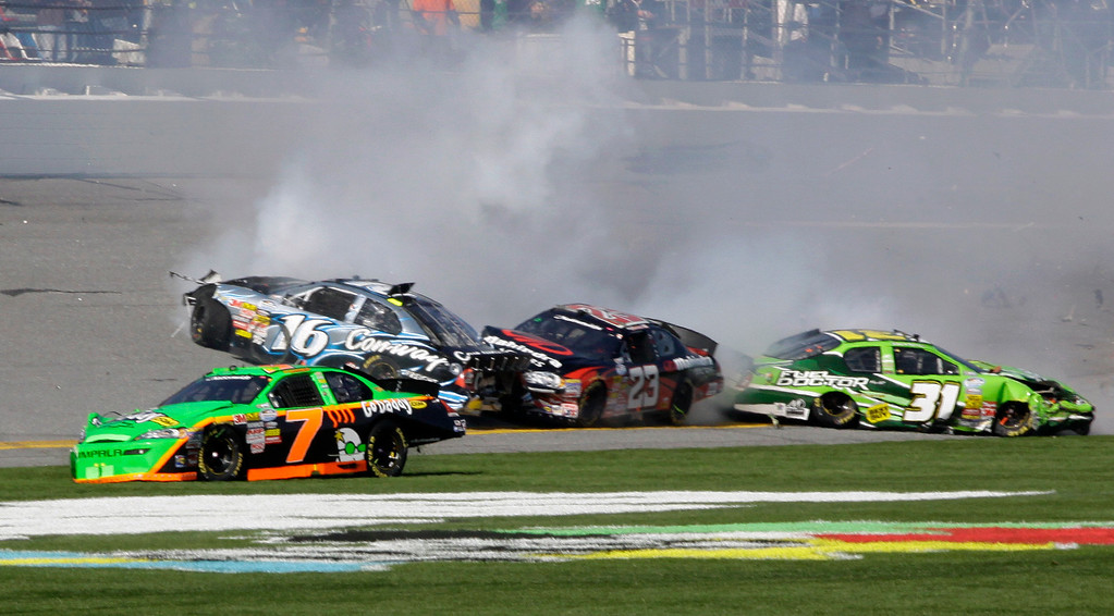 . Driver Danica Patrick (7) spins as she crashes along with Colin Braun (16), Robert Richardson Jr (23) and Stanton Barrett (31) during the NASCAR DRIVE4COPD 300 Nationwide series auto race at Daytona International Speedway in Daytona Beach, Fla., Saturday, Feb. 13, 2010. (AP Photo/Terry Renna)