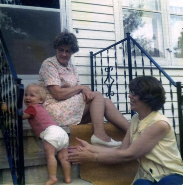 Grandmas Anita and Joyce playing with Michael