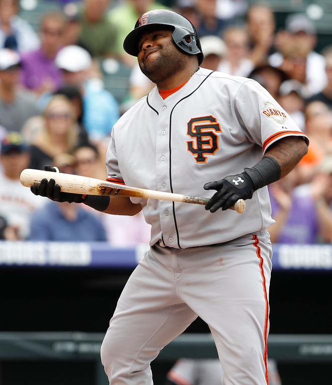 . San Francisco Giants\' Pablo Sandoval reacts after striking out against the Colorado Rockies in the first inning of a baseball game in Denver on Sunday, June 30, 2013. (AP Photo/David Zalubowski)