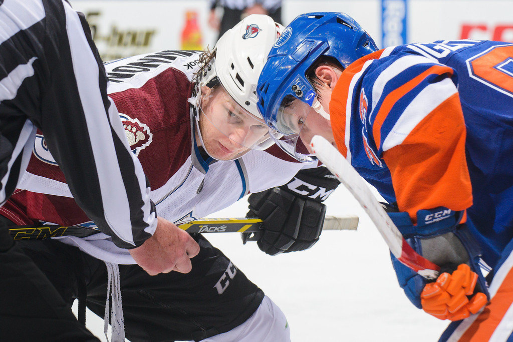 . Ryan Nugent-Hopkins #93 of the Edmonton Oilers faces off against Nathan MacKinnon #29 of the Colorado Avalanche during an NHL game at Rexall Place on April 8, 2014 in Edmonton, Alberta, Canada. The Avalanche defeated the Oilers 4-1. (Photo by Derek Leung/Getty Images)