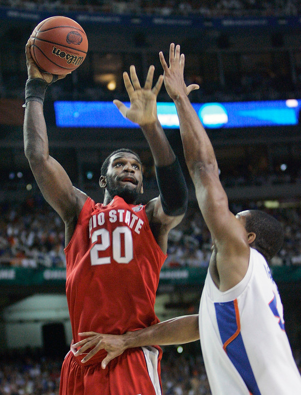 . Ohio State center Greg Oden (20) shoots over Florida\'s Al Horford (42) in the first half during their men\'s championship basketball game at the Final Four in the Georgia Dome in Atlanta Monday, April 2, 2007. (AP Photo/Gerry Broome)