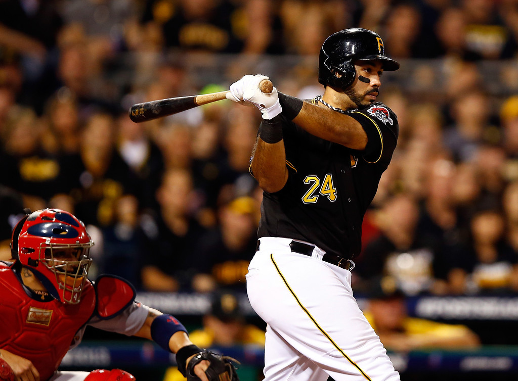 . Pedro Alvarez #24 of the Pittsburgh Pirates hits an RBI single in the eighth inning against the St. Louis Cardinals during Game Three of the National League Division Series at PNC Park on October 6, 2013 in Pittsburgh, Pennsylvania.  (Photo by Justin K. Aller/Getty Images)
