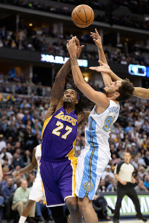 . DENVER, CO - NOVEMBER 13: Los Angeles Lakers center Jordan Hill (27) and Denver Nuggets shooting guard Evan Fournier (94) battle for a rebound during the second quarter November 13, 2013 at Pepsi Center. (Photo by John Leyba/The Denver Post)