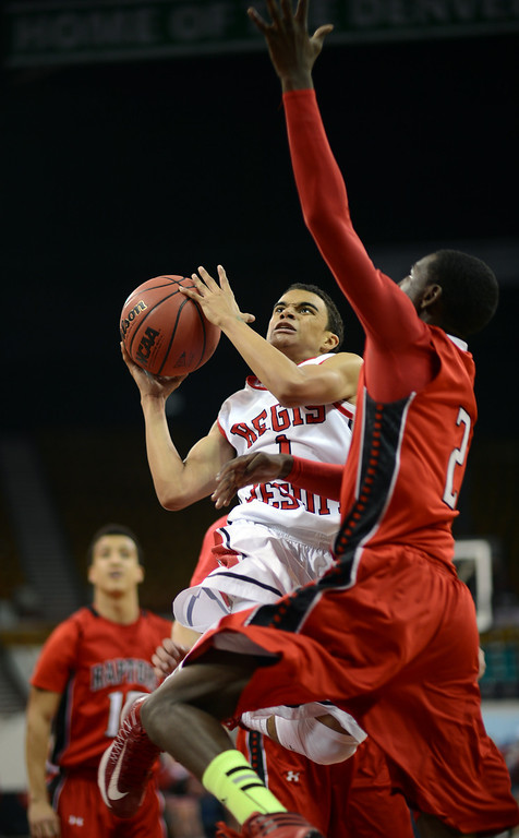 . DENVER, CO. - MARCH 08: Cam Beards #1 of Regis High School drives against TreShawn Wilford #2 of Eaglecrest High School during the playoff game at Denver Coliseum. March 8, 2013. Denver, Colorado. Eaglecrest won 64-57. (Photo By Hyoung Chang/The Denver Post)