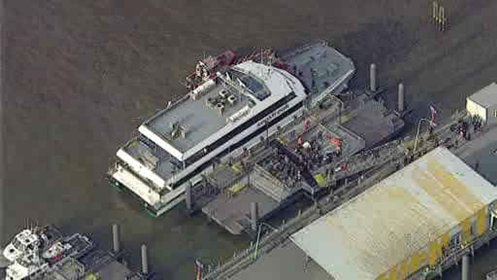 Description of . This aerial photo provided by WABC News Channel 7 shows emergency personnel at the scene of a ferry crash in Lower Manhattan, Wednesday, Jan. 9, 2013, in New York. The Fire Department says at least 50 people were injured when a ferry from New Jersey struck a dock during rush hour. (AP Photo/WABC News Channel 7)