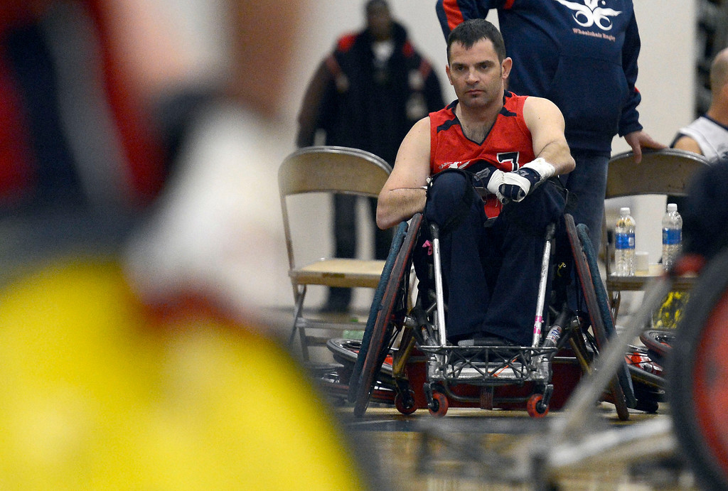 . DENVER, CO. - FEBRUARY 10: Coach Jason Regier of the Denver Harlequins watches from the sidelines during their game against the Northridge Knights at the Wheelchair Rugby Tournament February 10, 2013 at Englewood High School.  The Mile High Mayhem was put on by Craig Hospital and city of Englewood.(Photo By John Leyba/The Denver Post)