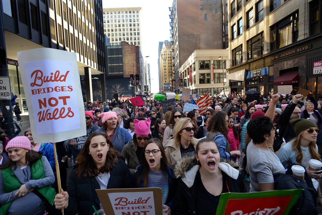 . Protesters rally against President Donald Trump during a women\'s march Saturday, Jan. 21, 2017, in Chicago.  The march is being held in solidarity with similar events taking place in Washington and around the nation. (AP Photo/Paul Beaty)