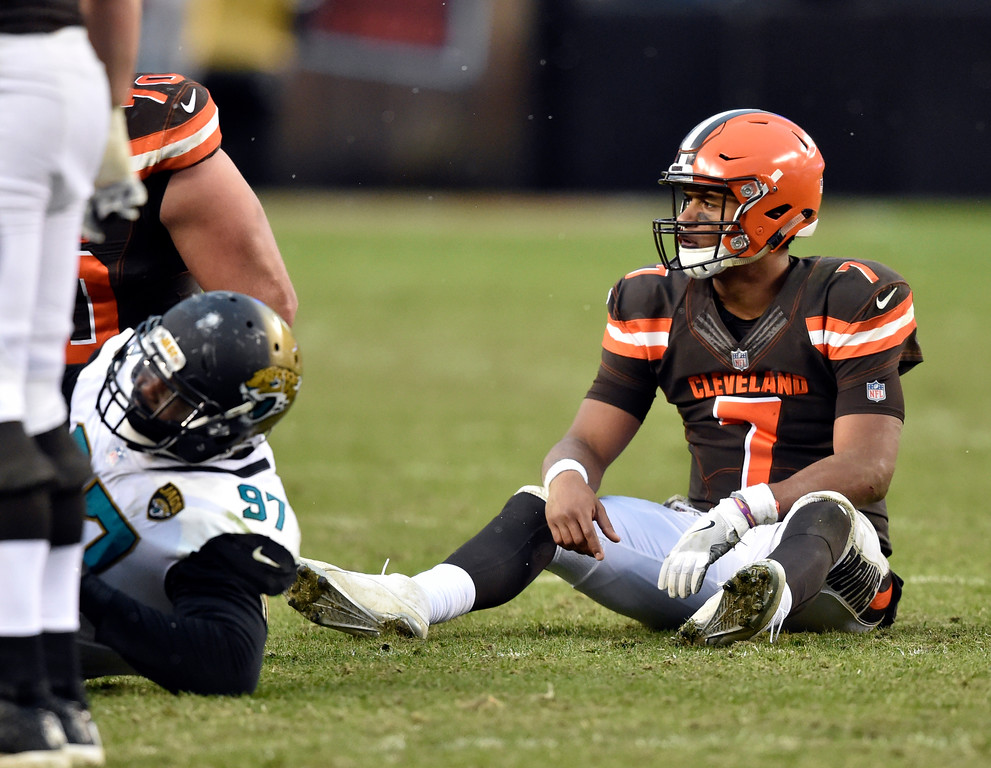 . Cleveland Browns quarterback DeShone Kizer (7) sits on the field after an incomplete pass in the second half of an NFL football game against the Jacksonville Jaguars, Sunday, Nov. 19, 2017, in Cleveland. (AP Photo/David Richard)