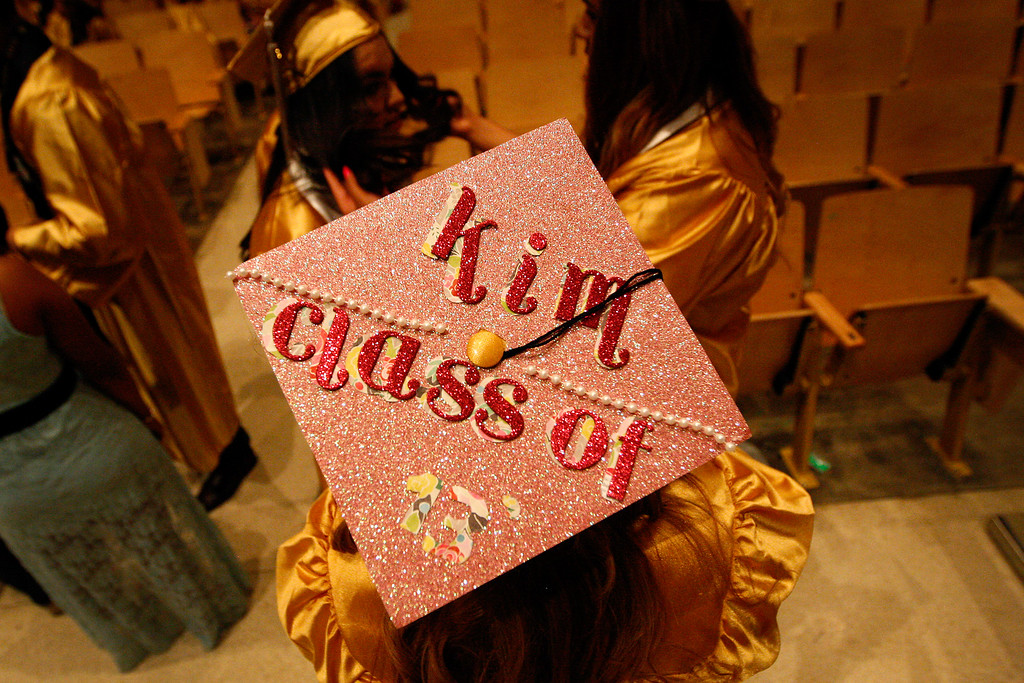 . Senior Kimberly Marcial is seen by her decorated cap before the San Fernando High School graduation ceremony on Thursday, June 06, 2013 in San Fernando, CA.  (Michael Yanow/Special to the L.A. Daily News)