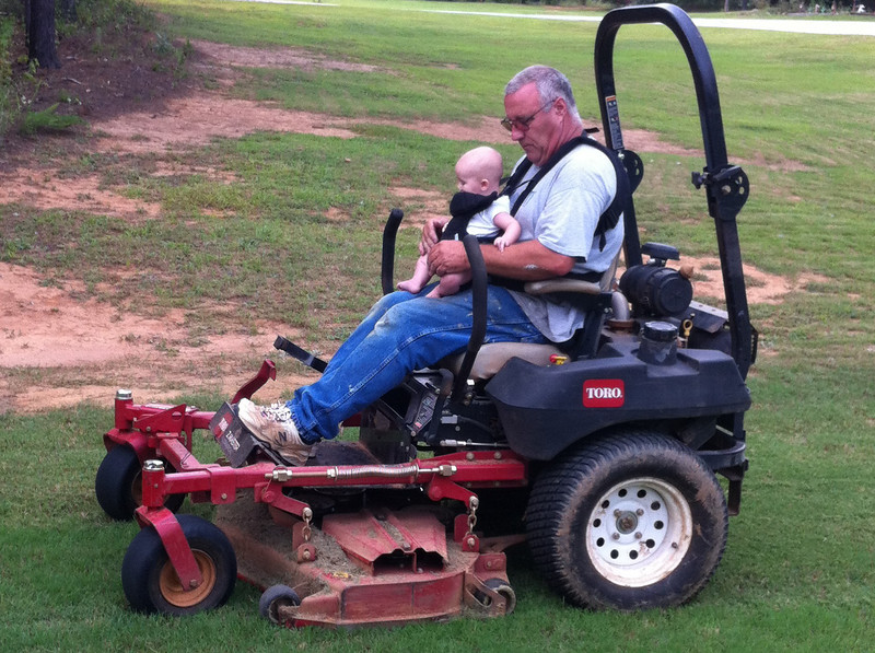 Breyden rides the mower with Grandpa for the first time - 5 Months and 2 days old.