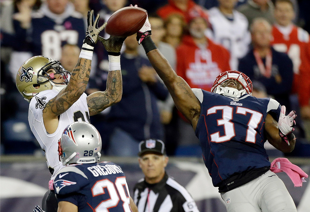. New Orleans Saints wide receiver Kenny Stills (84) catches a touchdown pass against the defense of New England Patriots cornerback Alfonzo Dennard (37), and strong safety Steve Gregory (28) in the fourth quarter of an NFL football game Sunday, Oct.13, 2013, in Foxborough, Mass. (AP Photo/Steven Senne)