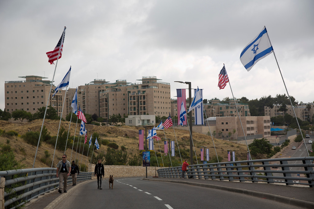 . Security officers walk on a road leading to the US Embassy compound ahead the official opening in Jerusalem, Sunday, May 13, 2018. Monday\'s opening of the U.S. Embassy in contested Jerusalem, cheered by Israelis as a historic validation, is seen by Palestinians as an in-your-face affirmation of pro-Israel bias by President Donald Trump and a new blow to frail statehood dreams. (AP Photo/Ariel Schalit)