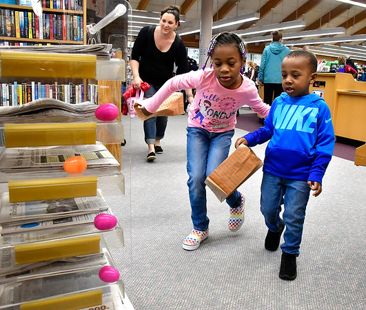 4/20/2019 Mike Orazzi | Staff Siblings Madison,7, and Aiden,3, David during the Manross Library Egg Hunt in Forestville on Saturday.