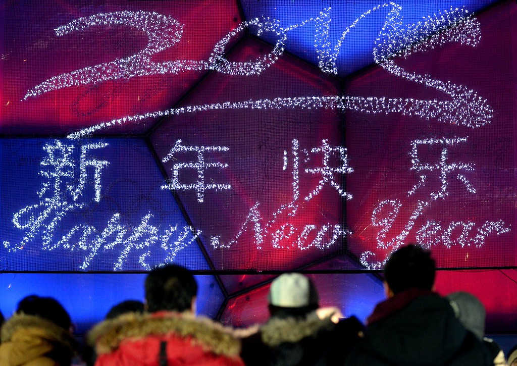 . People attend the New Year\'s Eve countdown event outside the Beijing\'s National Stadium, Known as the Bird\'s Nest in Beijing on January 1, 2015 . Beijing is bidding to host the 2022 Winter Olympic Games, with a decision on the winning city to be made in July 2015.        AFP PHOTO / WANG ZHAOWANG ZHAO/AFP/Getty Images
