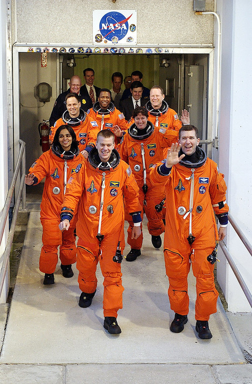 """. The crew of the Space Shuttle Columbia for mission STS-107, in the first row, Pilot William \""""Willie\"""" McCool (L) and Commander Rick Husband (R), second row are Mission Specialists Kalpana Chawla (left) and Laurel Clark (R) in the last row, Payload Specialist Ilan Ramon, Payload Commander Michael Anderson and Mission Specialist David Brown walk to the launch pad on January 16, 2003 at Kennedy Space Center at Cape Canaveral, Florida. Mission STS-107 is a 16-day scientific mission. Payload Specialist Ilan Ramon is the first Israeli astronaut. (Photo by NASA/Getty Images)"""