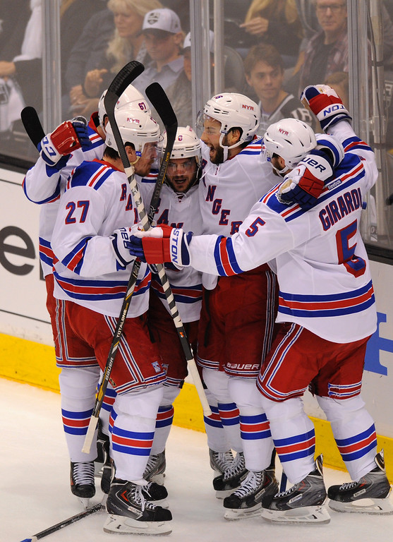 . The Rangers\' Mats Zuccarello, center, is congratulated by teammates after his first-period goal against the Kings in the first period in game two of the Stanley Cup Final, Saturday, June 7, 2014, at Staples Center. (Photo by Michael Owen Baker/Los Angeles Daily News)