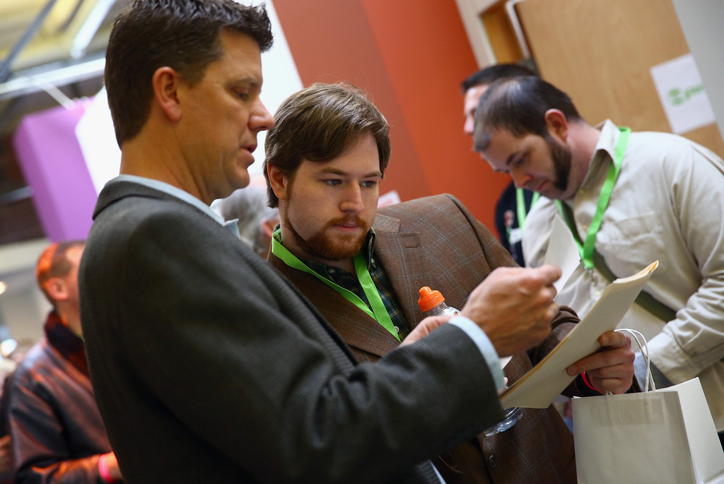 . Dylan Horne (C) of Jackson, Mississippi talks with Ralph Morgan (L), COO of O.PenVAPE and Organa Labs at CannaSearch, Colorado\'s first cannabis job fair, on March 13, 2014 in Denver, Colorado. O.PenVAPE, the largest national brand in cannabis, held the first of its kind Cannabis Job Fair hoping to match applicants with businesses in the Colorado marijuana industry.  (Photo by Doug Pensinger/Getty Images)