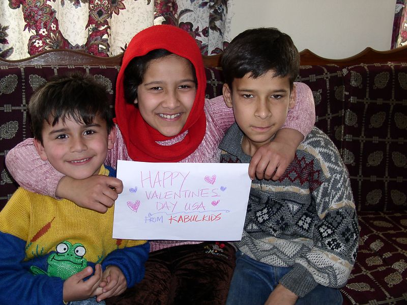 Happy Valentine's Day from the first 3 kids to get shoes, Omar, Meetsa and Ali.