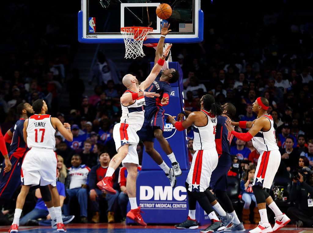 . Detroit Pistons\' Reggie Jackson drives on Washington Wizards center Marcin Gortat (4) in the second half of an NBA basketball game in Auburn Hills, Mich., Sunday, Feb. 22, 2015. (AP Photo/Paul Sancya)