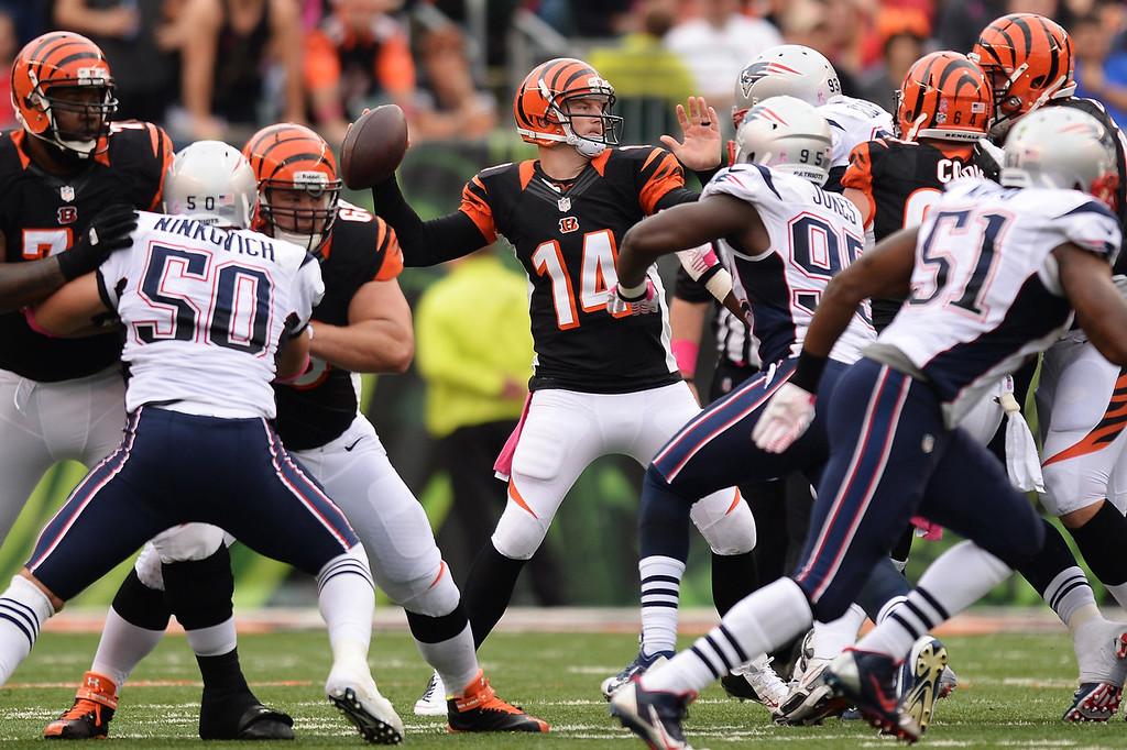 . Quarterback Andy Dalton #14 of the Cincinnati Bengals passes in the second quarter against the New England Patriots at Paul Brown Stadium on October 6, 2013 in Cincinnati, Ohio.  (Photo by Jamie Sabau/Getty Images)