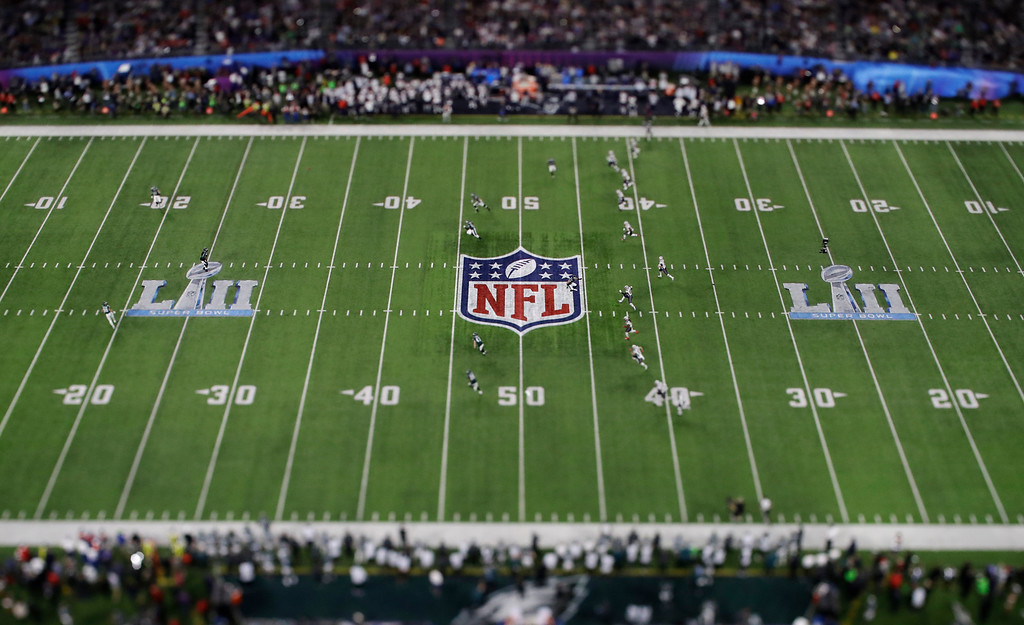 . In this picture made with a specialty lens the New England Patriots kick off to the Philadelphia Eagles during the first half of the NFL Super Bowl 52 football game Sunday, Feb. 4, 2018, in Minneapolis. (AP Photo/Matt Slocum)