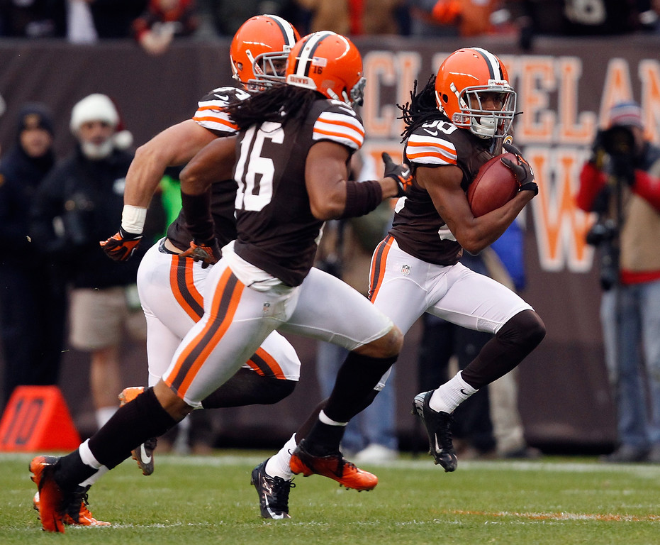 . CLEVELAND, OH - DECEMBER 09:  Wide receiver Travis Benjamin #80 of the Cleveland Browns scores a touchdown as he runs with wide receiver Joshua Cribbs #16 against the Kansas City Chiefs at Cleveland Browns Stadium on December 9, 2012 in Cleveland, Ohio.  (Photo by Matt Sullivan/Getty Images)