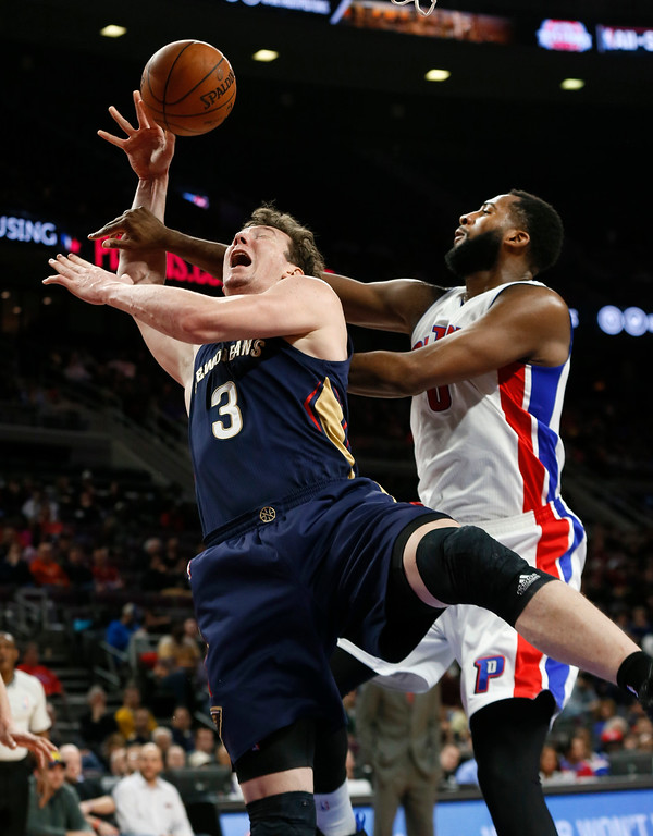 . New Orleans Pelicans center Omer Asik (3) is fouled by Detroit Pistons center Andre Drummond (0) during the second half of an NBA basketball game in Auburn Hills, Mich., Wednesday, Jan. 14, 2015. (AP Photo/Paul Sancya)