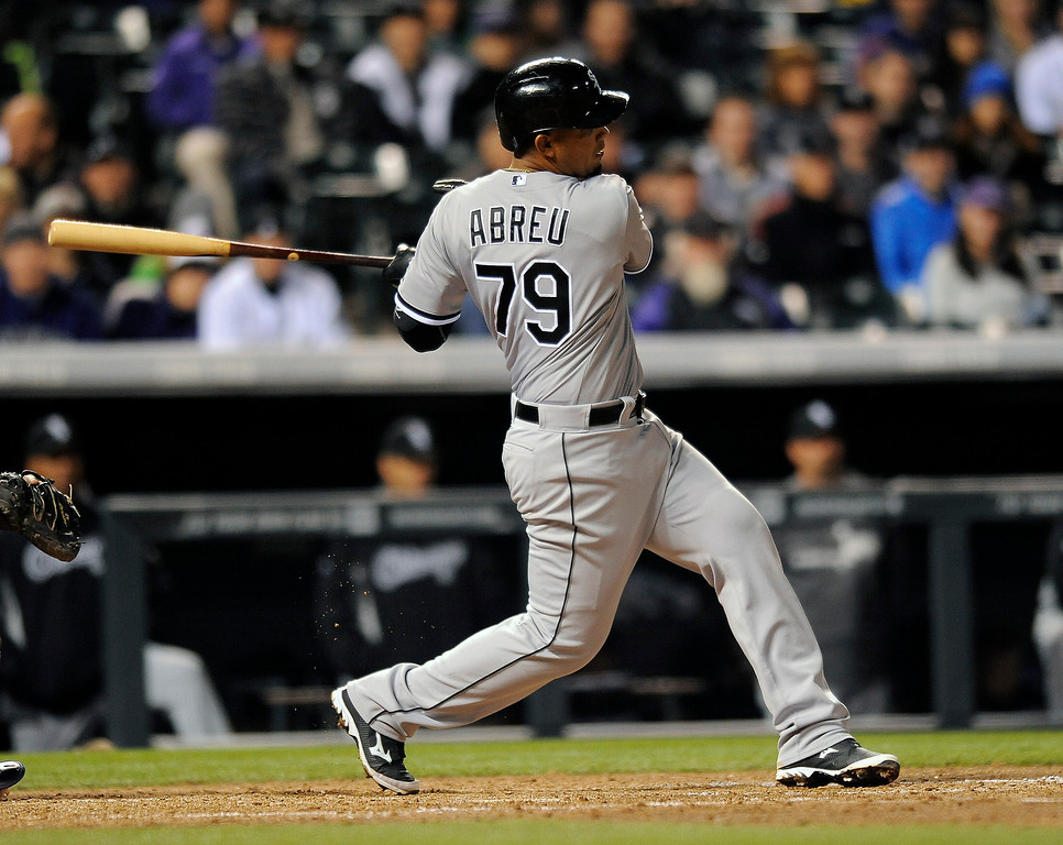 . Chicago White Sox Jose Abreu bats in the sixth inning of a baseball game against the Colorado Rockies on Monday, April 7, 2014, in Denver. The Rockies won 8-1. (AP Photo/Chris Schneider)